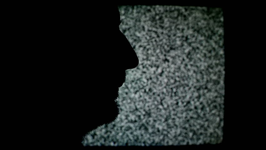 Unshaven man profile silhouette in front of static TV noise background. 1920x1080 full hd footage. | Shutterstock HD Video #6869074