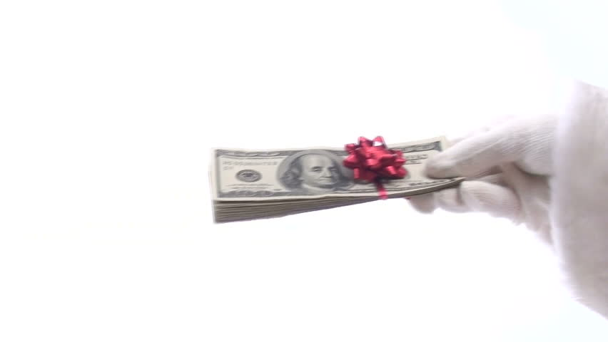 Generous Santa gives stack of cash topped with festive bow isolated on white