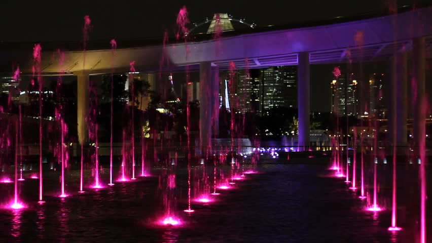 4k shot of lights shining on the stage of an empty strip club fountains at marina barrage singapore at night displaying multiple colors can aloadofball Image collections