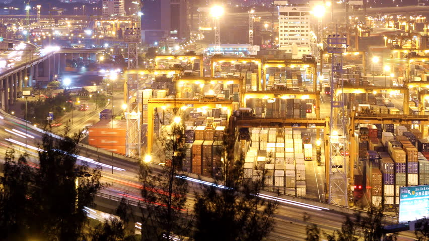 Busy City Night Timelapse. Pan shot from cargo container terminal at the right to busy traffic highway at the left.