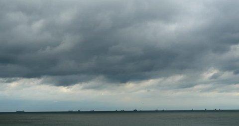 4k sparkling ocean sea water waves surface&coastal rock reef coast cloud cloudscape.dark clouds. gh2_08293_4k