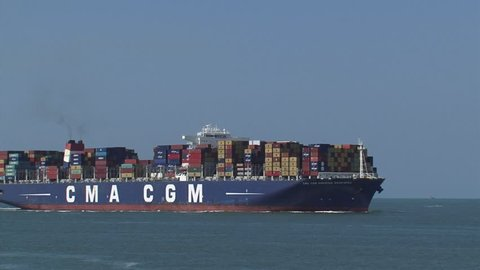 PORT OF ROTTERDAM - JULY 2014: Large container ship CMA CGM Amerigo Vespucci navigates on Eurogeul, North Sea, bound for Rotterdam. The Eurogeul allows deep-water sea access to the Port of Rotterdam.