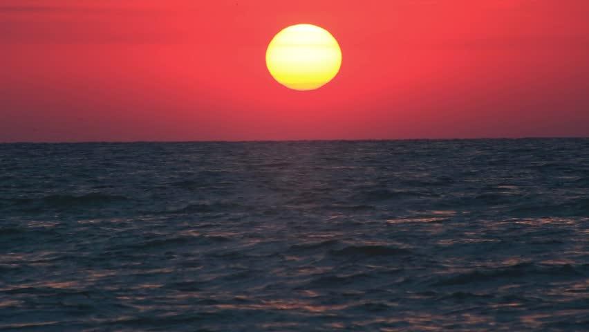 rising sun over the sea - HD stock video clip