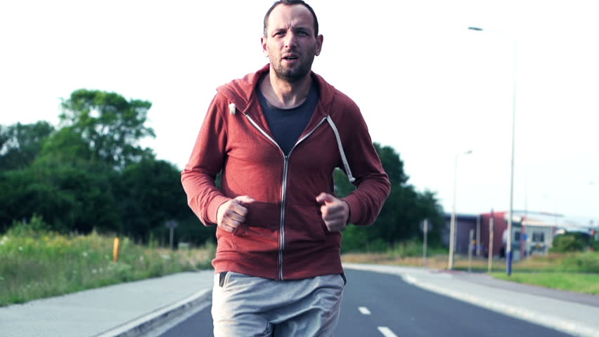 2cb0790fc3e5 Young, Sportive Man Jogging in Stock Footage Video (100% Royalty ...