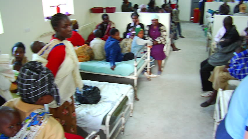 NAKURU, KENYA AFRICA - CIRCA 2011: Busy African hospital waiting area with beds, children, mothers, babies.