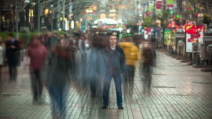 The man stand in the crowd stream - original time lapse video with smashed people in the crowd. Made of  long exposure RAW stills   Shutterstock HD Video #7030039