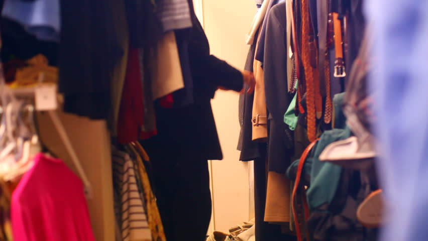 A Walk In Closet Looking For A Jacket   HD Stock Footage Clip