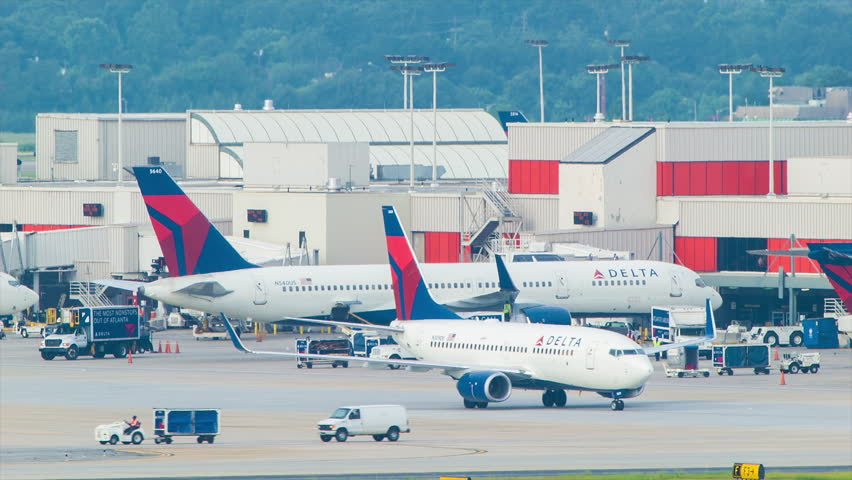 atlanta 2014 atlanta airport terminal activity featuring delta airlines commercial passenger aircraft and ground