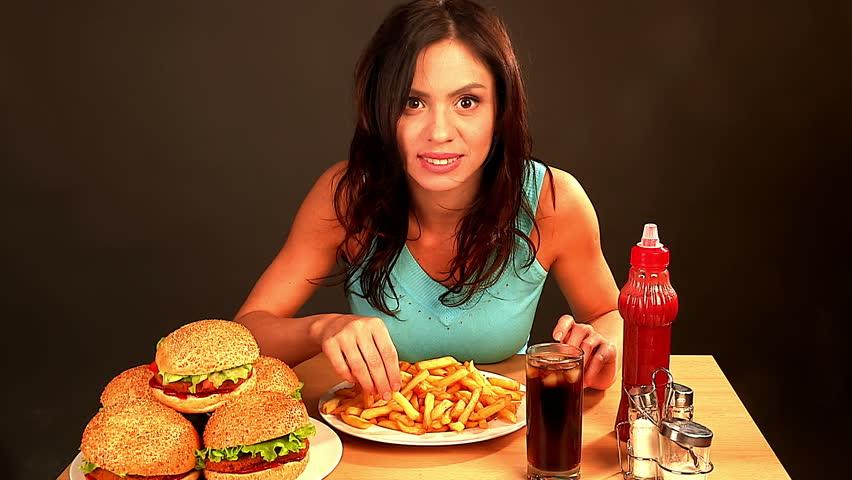 Woman Eating Fast Foodslim Girl Absorbs Huge Amount Of -1385