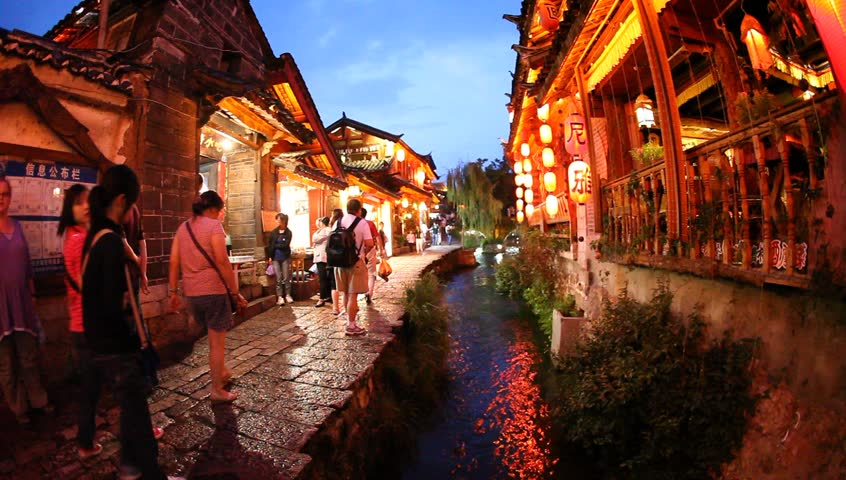 Lijiang, China - August 20: In the peak of the season, Chinese and world travelers enjoy  old town Lijiang including old architecture, restaurants and the local river in Yunnan, August 20, 2009
