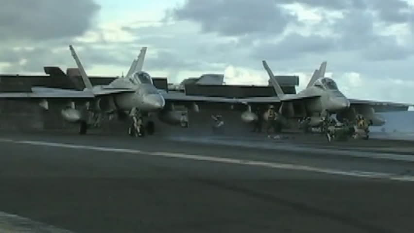 CIRCA 2010s - Jets land and take off from the deck of an aircraft carrier.