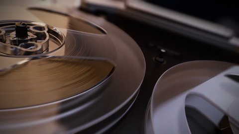 Old Retro Reel Audio Recorder reels spinning. Macro. Loopable animation.