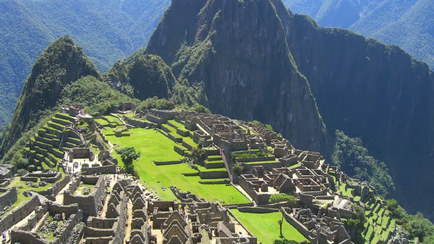 Time Lapse Movie over ruins of Machu Picchu in Peru with some tourists walking by
