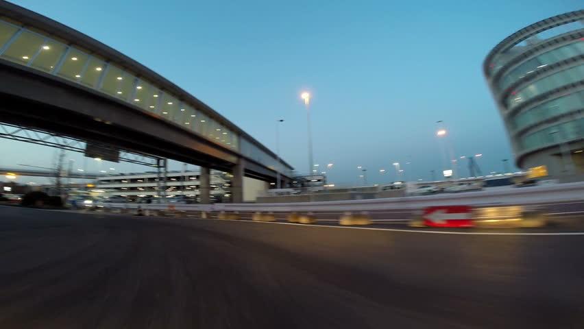 Twilight cruise around Tokyo International Airport Terminal 1 at twilight. | Shutterstock HD Video #7164994
