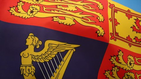 The Royal Standard of the United Kingdom. This flag is used by Queen Elizabeth II in her capacity as Sovereign of the United Kingdom and its overseas territories.