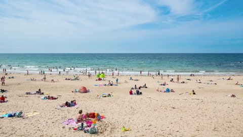 SABLES D'OR, FRANCE - AUGUST 7, 2014: People relaxing at the beach. Sables-d'Or-les-Pin s is a French Seaside resort, located in the Cotes-d'Armor in Brittany, France. It was created in 1921.