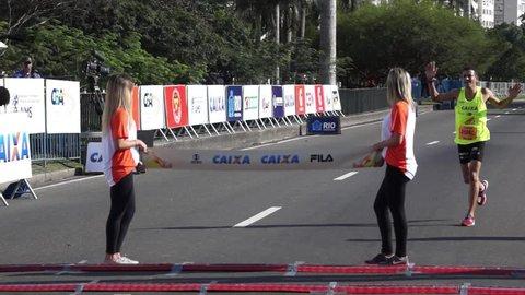 RIO DE JANEIRO, August,31: XVIII Meia Maratona do Rio 2014. Clodoaldo Azevedo Ferreira da Silva and Joao Marcos Silva, Brazilians, crosses the finish line. Rio de Janeiro, Brazil .August, 31, 2014
