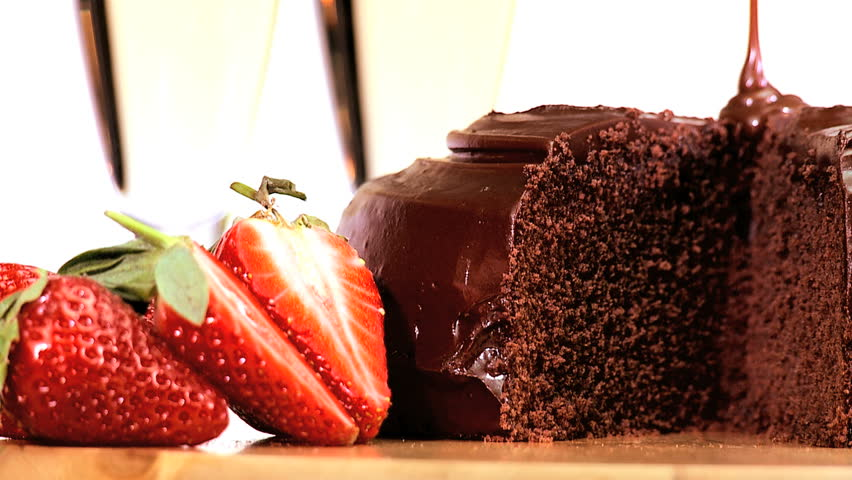 Indulgent sticky chocolate cake served with fresh strawberries & sparkling white wine