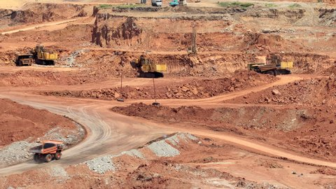 zoom out mining dump trucks and excavators
