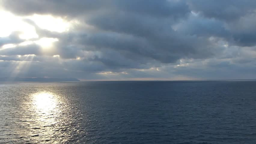 Landscape from the sea._18 / Location: Sea of Pacific Ocean near the Sea of Japan. Date:September 3, 2014/  Taken from shipboard clouds and sunrise and the morning sun over the Pacific Ocean.