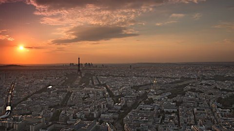 paris skyline aerial day to night timelapse at the sunset to night city lighting up sparking eiffel tower panorama from montparnasse