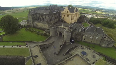 Flying over castle in Stirling, Scotland on a summer day