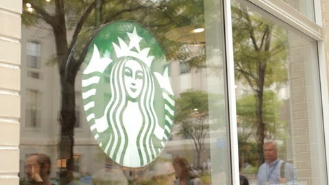 BOSTON, MA - SEPT 12: Starbucks Coffee exterior facade open for business on September 12, 2014. Starbucks Coffee is the largest coffeehouse company in the world.