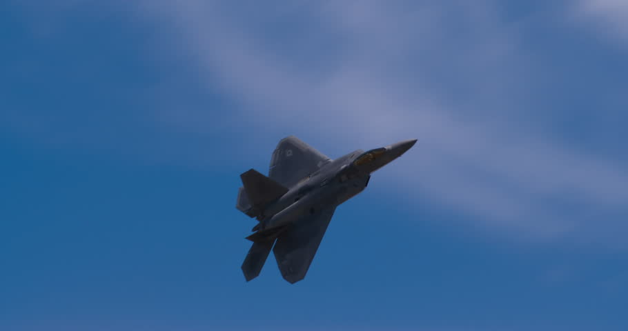 F22 Raptor fighter plane passing over camera