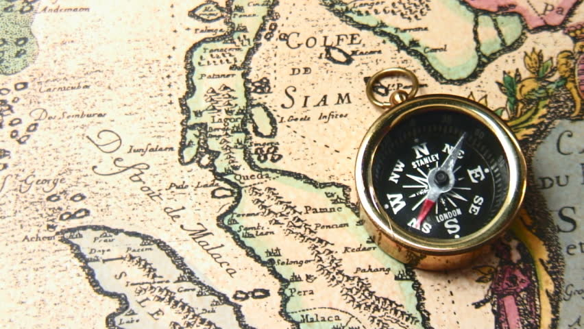 Small cartoon sailing ship moves from southern hemisphere to old brass compass over antique map spinning around hd stock footage clip gumiabroncs Choice Image
