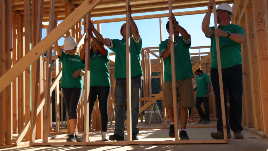 Volunteers working together lifting wall | Shutterstock HD Video #7332979