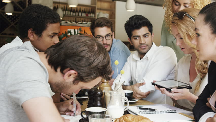 Mixed race group of people small business startup team meeting in cafe   Shutterstock HD Video #7363636