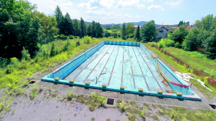 ljubljana slovenia august 2014 aerial shot of empty olympic swimming pool old unused pool complex bankrupt empty pools and overgrown with grass and
