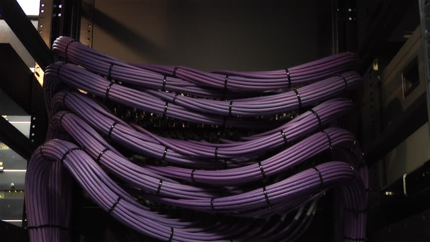 This high definition footage is of a video server cables. The camera pans slowly down to reveal a organized video cable structure in HDV format. Other formats available