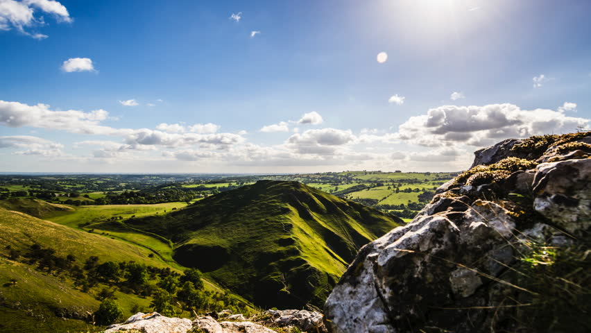 Amazing mountain view landscape on a sunny day, with clouds moving, sun shinning and beautiful green hills on the Peak District, time lapse, Pro Res 422, 4K and HD