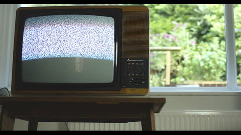 Analogue television disappears from UK airwaves. 76 years of television history came to an end at midnight on Wednesday 24 October 2012 when the analogue TV signal was switched off. (UK, July 2014)