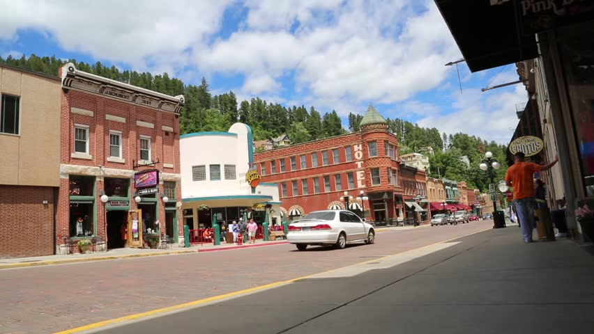 Deadwood, South Dakota, July 2014: Traffic and tourists mingle on Main Street in the tourist town of Deadwood, South Dakota, July 2014.