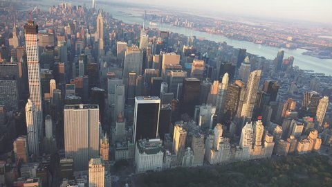 New York City tlooking downtown from midtown aerial. Sunrise and early morning light. Shot in 4K, dedicated plane, hard mounted open window allows a saturated, clear edge on the shot.