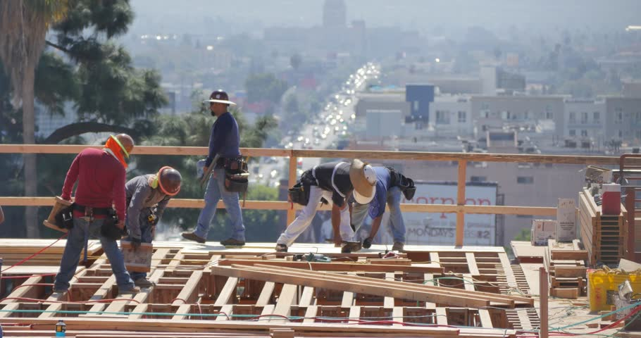 LOS ANGELES - September 30, 2014: Construction workers working on high storeys apartment building site in LA, California.