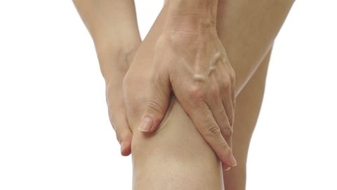 Close up shot of an anonymous woman massaging and rubbing her knee to relieve pain and stiffness in her joint.