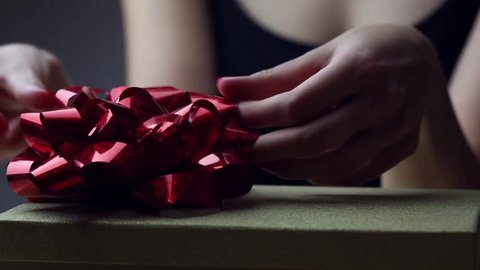 Woman hands  on christmas gift