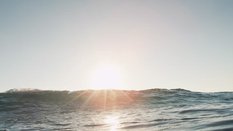 Small wave breaking on camera shot in slow-motion from underwater. Shot on RED Cinema Camera in 4K, crop, rotate and zoom easily. H264 codec High bit rate.