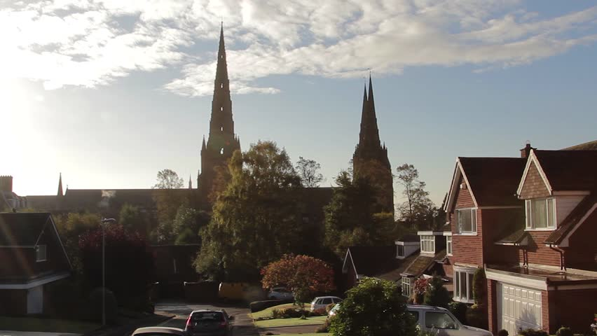 Tilt Silhouette Three Spires Historic Lichfield Cathedral Lens Flare Big Blue Sky High Angle Rooftop View - Lichfield, UK  Location: Lichfield, Staffordshire, England, UK  Source: Canon 5DMkiii