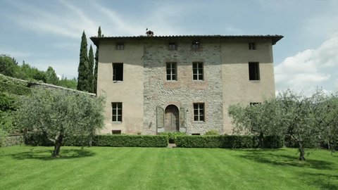Glide towards an old villa in Tuscany.