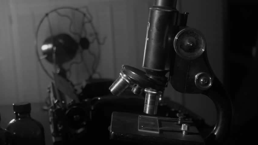 Camera dollies around a vintage microscope and telephone | Shutterstock HD Video #7639324