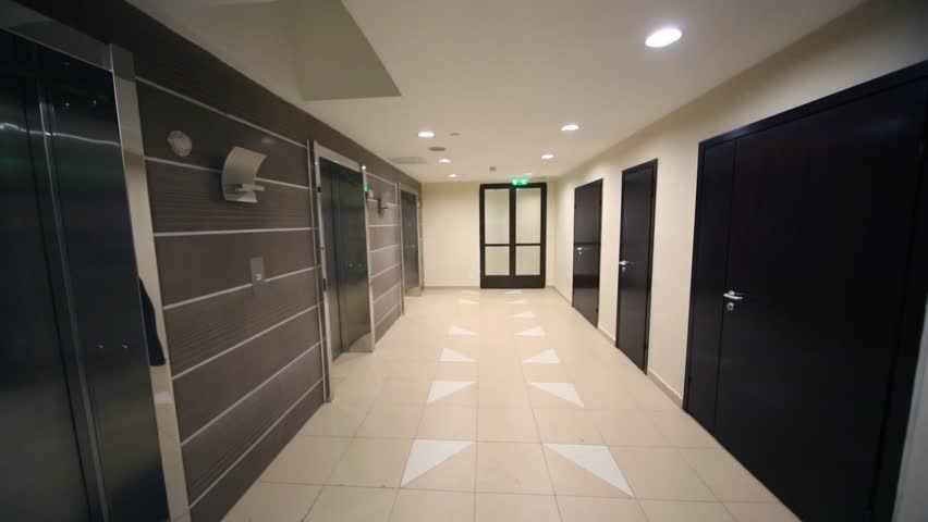 Metal doors of lifts in empty new residential building - HD stock video clip