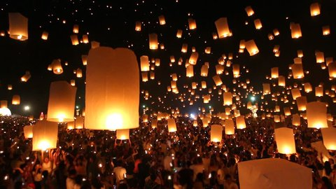 Many Sky Fire Lanterns Floating Up To The Sky In Yee Peng Lanna International Landmark Destination Travel Of Chiang Mai, Thailand (tilt up)
