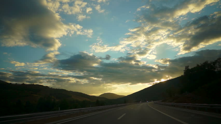 Car ride at dusk. A look on the scenic landscape.   Shutterstock HD Video #7760914