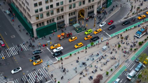 NEW YORK - MAY 7: (Time-lapse/Zoom-in) Traffic and pedestrians move along 5th Avenue thru Madison Square between 23rd and 24th Streets in a tilt-shift miniature effect view on May 7, 2014 in New York.