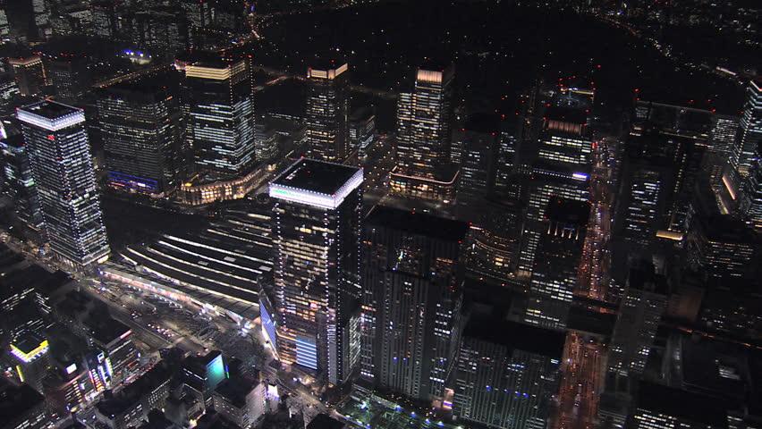 Aerial overhead illuminated Metropolis night Tokyo National Rail station skyscrapers travel Business district Japan Asia