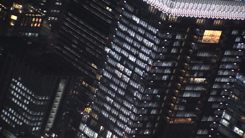 Aerial Tokyo close up city office buildings night illuminated people skyscrapers Shibuya built structure Business District Japan Asia | Shutterstock HD Video #7792504